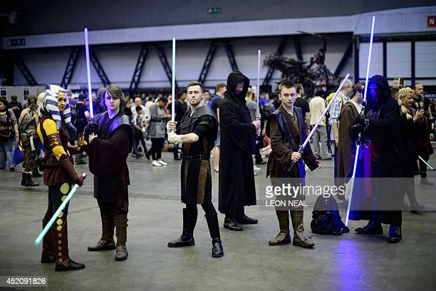 Fans dressed as Jedi Knights from the Star Wars universe at the London Film and Comic Con 2014 in Earls Court west London on July 13 2014 The event...