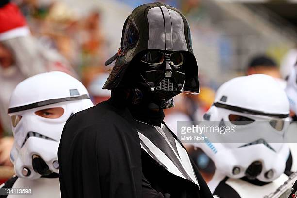 Fans dressed as Star Wars Imperial Troopers and Darth Vader pose for a photo during day two of the Gold Coast Sevens World Series at Skilled Park on...
