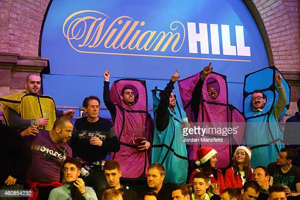 Fans dressed as Tetris enjoy the atmosphere during Day Seven of the William Hill PDC World Darts Championships at Alexandra Palace on December 27...