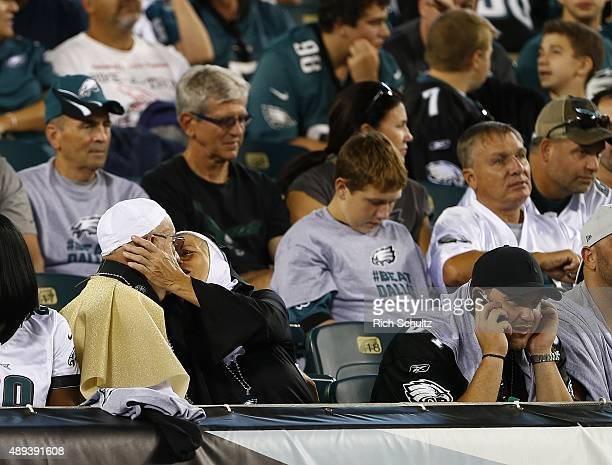 Fans dressed as the Pope and a nun kiss during a game between the Dallas Cowboys and Philadelphia Eagles at Lincoln Financial Field on September 20...