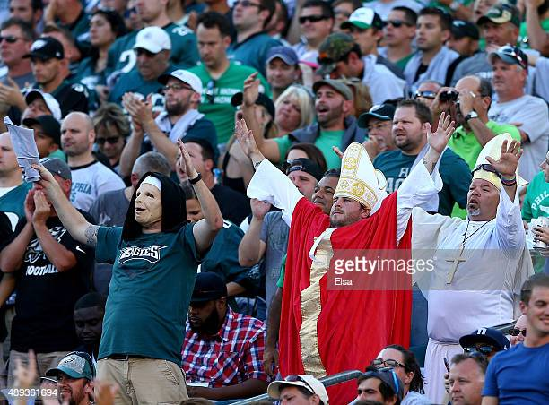 Fans dressed as the Pope attend the game between the Philadelphia Eagles and the Dallas Cowboys on September 20 2014 at Lincoln Financial Field in...