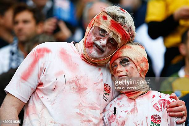 Fans dressed for Halloween in England shirts enjoy the build up to the 2015 Rugby World Cup Final match between New Zealand and Australia at...