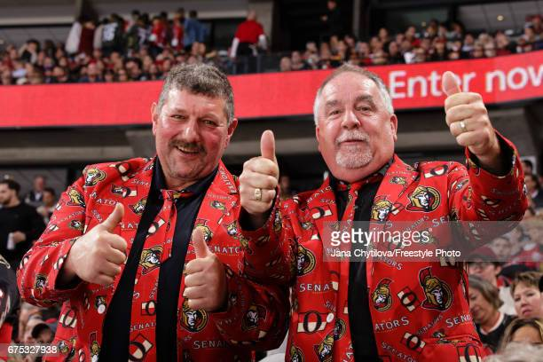 Fans dressed in a suit with the home team pattern on it ham it during a game between the Ottawa Senators and the New York Rangers in Game Two of the...