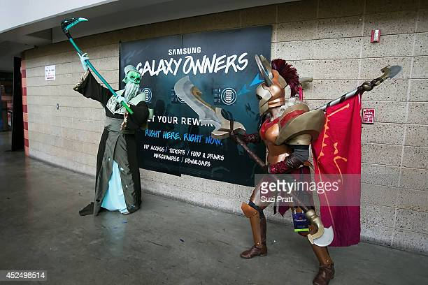 Fans dressed in cosplay pose for a photo at The International DOTA 2 Championships at Key Arena on July 21 2014 in Seattle Washington