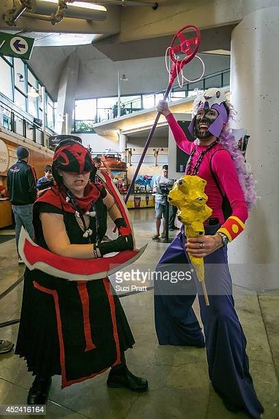 Fans dressed in cosplay pose for photos at The International DOTA 2 Champsionships at Key Arena on July 19 2014 in Seattle Washington