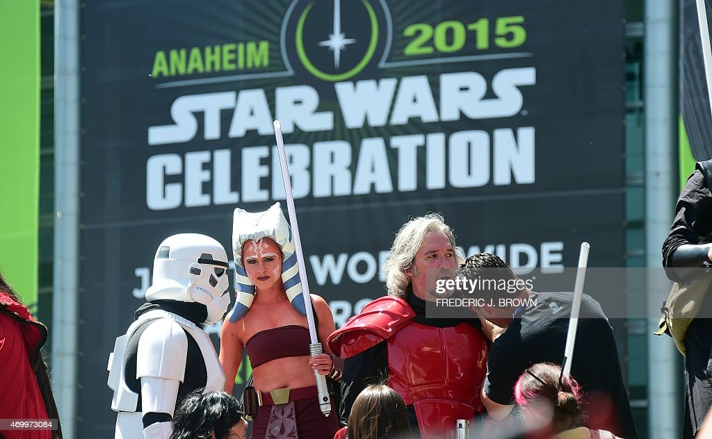 Fans dressed in costumes attend on the opening day of the 25th Star Wars Convention on April 16, 2015 in Anaheim, California, where some 100,000 fans are expected for the four day convention.