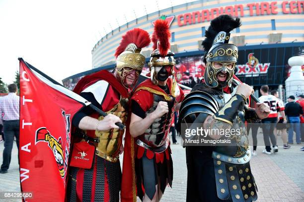 Fans dressed up as gladiators pose outside the arena prior Game Three of the Eastern Conference Final between the Pittsburgh Penguins and the Ottawa...