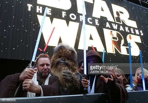 Fans dressed up as Star Wars character pose ahead of the European Premiere of 'Star Wars The Force Awakens' in central London on December 16 2015...