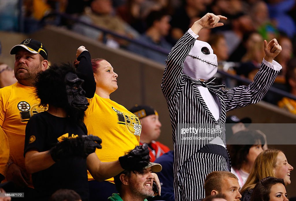 Fans dressed up for Halloween cheer during the game between the Boston Bruins and the Anaheim Ducks at TD Garden on October 31, 2013 in Boston, Massachusetts.