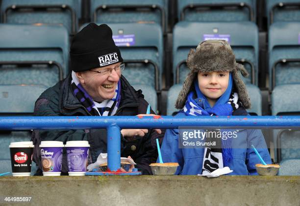 Fans enjoy a pie ahead of the FA Cup with Budweiser Fourth Round match between Rochdale and Sheffield Wednesday at Spotland on January 25 2014 in...