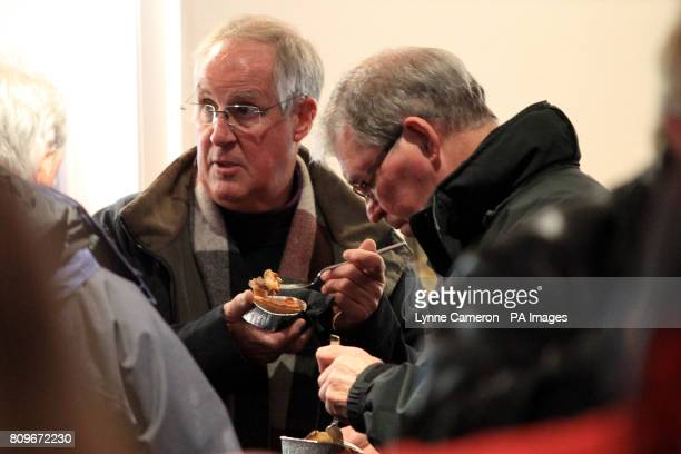 Fans enjoy free pies in the Thistle Bar before kick off