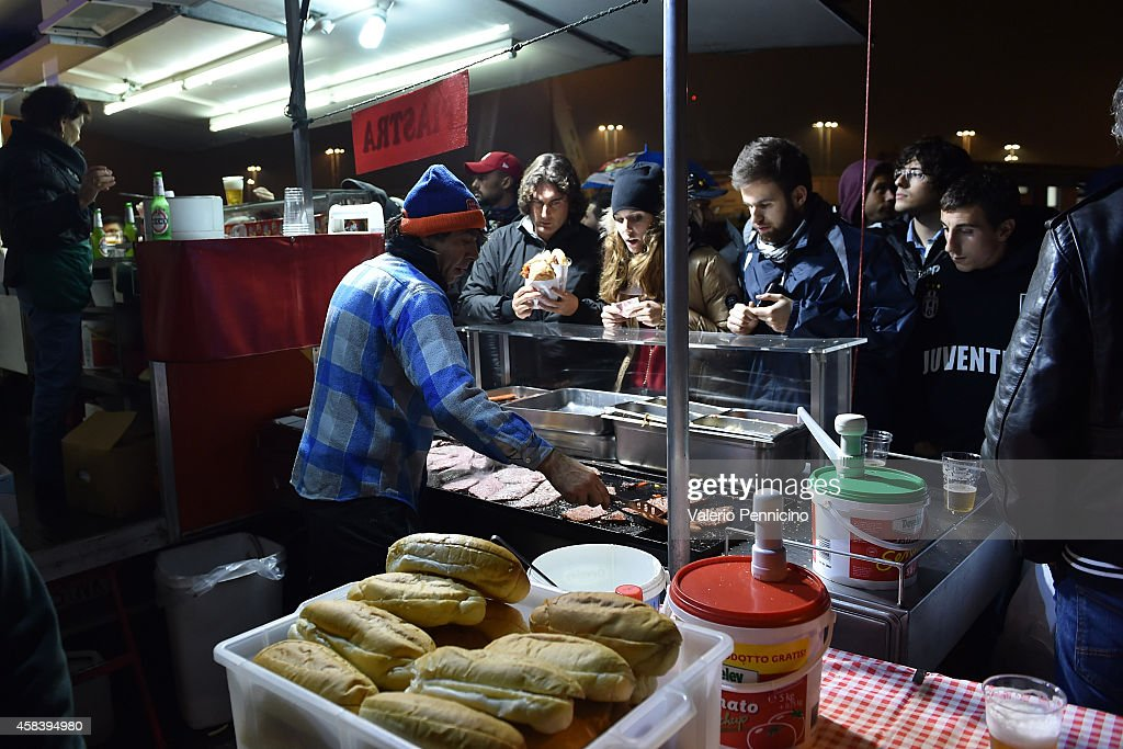 Fans enjoy refreshments outside the ground prior to the UEFA Champions League group A match between Juventus and Olympiacos FC at Juventus Arena on...