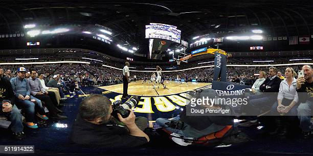 Fans enjoy the action from courtside seats as the Sacramento Kings defeated the Denver Nuggets 114110 at Pepsi Center on February 23 2016 in Denver...