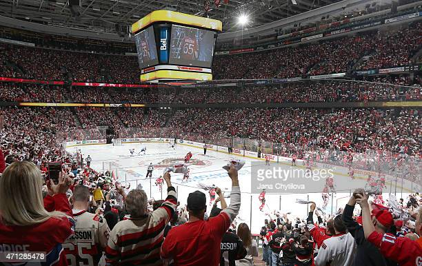 Fans enjoy the atmosphere as both teams take to the ice prior to the start of a game between the Ottawa Senators and the Montreal Canadiens in Game...