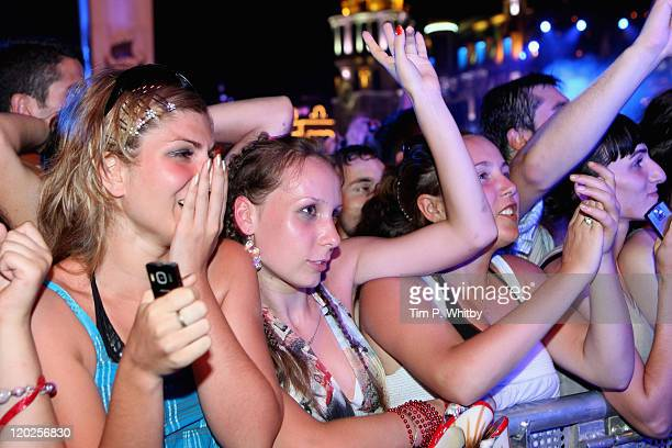 Fans enjoy the atmosphere as they watch singer Enrique Iglesias perform on stage during MTV Live Georgia at Europe Square on August 2 2011 in Batumi...