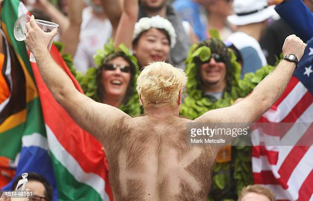 Fans enjoy the atmosphere during day three of the 2014 Hong Kong Sevens at Hong Kong International Stadium on March 30 2014 in Hong Kong Hong Kong