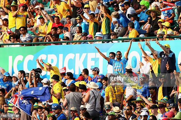 Fans enjoy the atmosphere during the 2015 Cricket World Cup Semi Final match between Australia and India at Sydney Cricket Ground on March 26 2015 in...