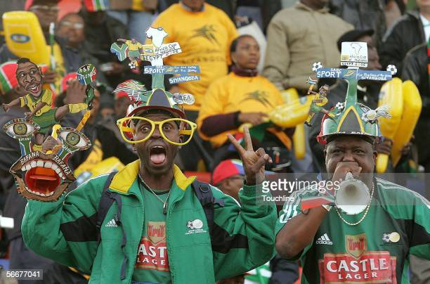 Fans enjoy the atmosphere during the African Cup of Nations match between Guinea and Zambia at the Border Guard Stadium on January 26 2006 in...