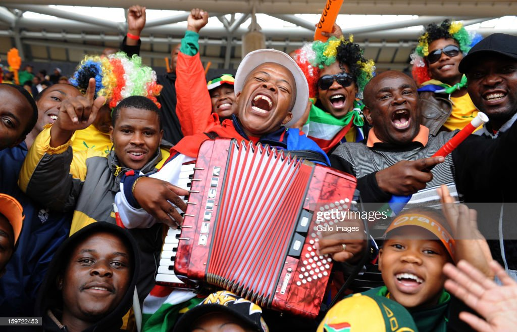 Fans enjoy the atmosphere during the opening ceremony of the 2013 African Cup of Nations at the National Stadium on January 19 2013 in Johannesburg...