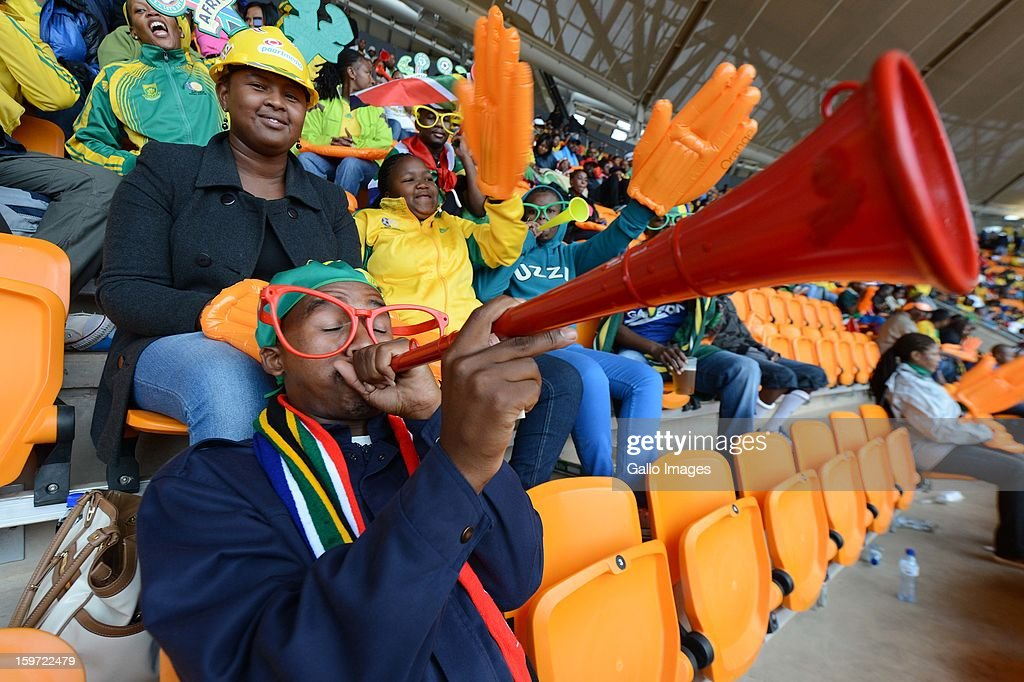 Fans enjoy the atmosphere during the opening ceremony of the 2013 African Cup of Nations at the National Stadium on January 19, 2013 in Johannesburg, South Africa.