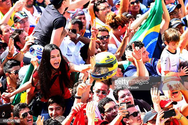 Fans enjoy the atmosphere in the pit lane after the Brazilian Formula One Grand Prix at Autodromo Jose Carlos Pace on November 9 2014 in Sao Paulo...