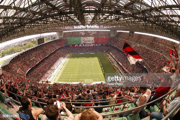 Fans enjoy the atmosphere in the stadium during the Serie A match between AC Milan and Brescia at the Stadio Giuseppe Meazza on May 16 2004 in Milan...