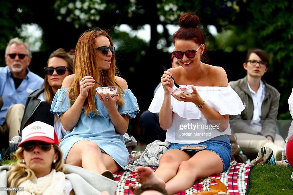 Fans enjoy the atmosphere on Murray Mound during day two of the Wimbledon Lawn Tennis Championships at the All England Lawn Tennis and Croquet Club on June 28, 2016 in London, England.