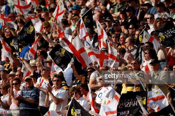 Fans enjoy the atmosphere on St George's day during the AVIVA Premiership match between London Wasps and Bath at Twickenham Stadium on April 23 2011...