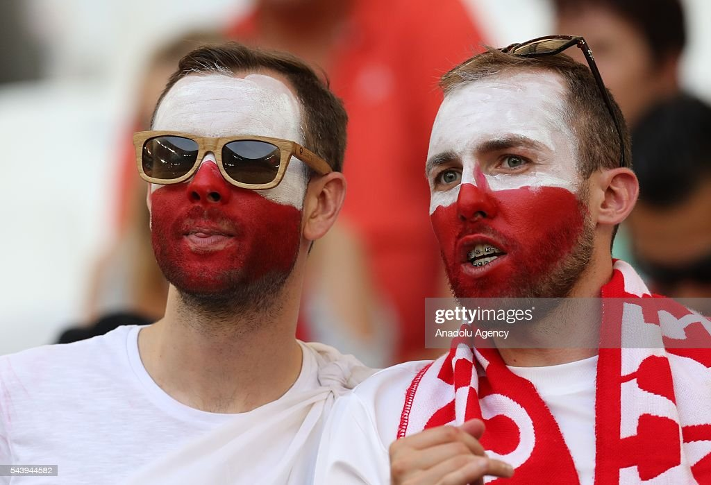 Fans enjoy the atmosphere prior to the Euro 2016 quarter-final football match between Poland and Portugal at the Stade Velodrome in Marseille, France on June 30, 2016.