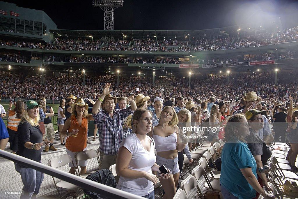 Fans enjoy the Jason Aldean concert at Fenway Park, Friday, July 12, 2013.