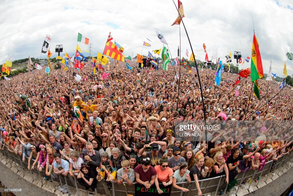Fans enjoy the music as US singer Dolly Parton performs on the Pyramid Stage on the final day of the Glastonbury Festival of Music and Performing...