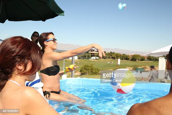 Fans enjoy the pool overlooking the 18th hole during the final round of the Shriners Hospitals For Children Open at TPC Summerlin on October 19 2014...