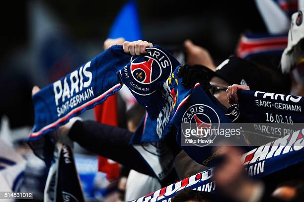 PSG fans enjoy the pre match atmosphere during the UEFA Champions League round of 16 second leg match between Chelsea and Paris Saint Germain at...