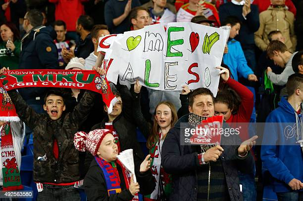 Fans enjoy themselves before the UEFA EURO 2016 Group B Qualifier between Wales and Andorra at Cardiff City stadium on October 13 2015 in Cardiff...
