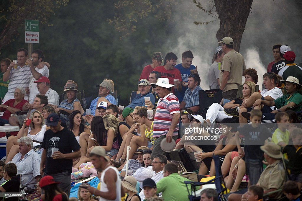 Fans enjoy themselves with beer and barbeques during the third One Day International (ODI) cricket match in the three game series between South Africa and New Zealand, on January 25, 2013 at Senwes Park Stadium in Potchefstroom. New Zealand have won the first two ODI's. BOSCH