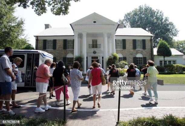 Fans enter Graceland Mansion the home of Elvis Presley for a tour 15 August 2007 in Memphis Tennessee Elvis fans from around the world are gathering...