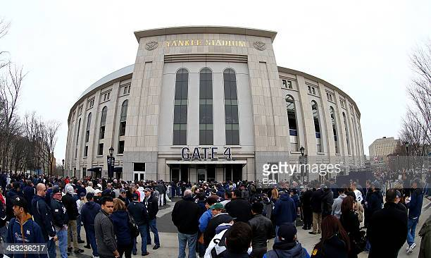 Fans enter the stadium before the home opener between the Baltimore Orioles and the New York Yankees on April 7 2014 at Yankee Stadium in the Bronx...