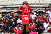 Fans express their emotions during the funeral service of the late Senzo Meyiwa at Moses Mabhida Stadium on November 01 2014 in Durban South Africa...