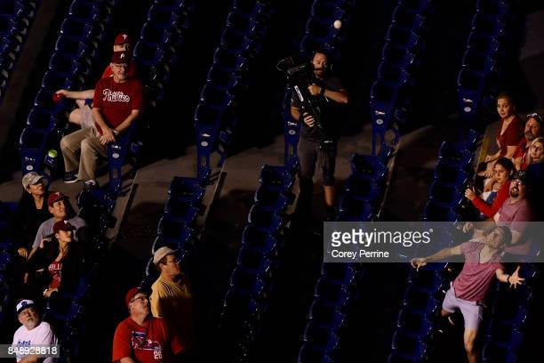 Fans eye a foul ball between the Philadelphia Phillies and the Oakland Athletics during the eighth inning at Citizens Bank Park on September 16 2017...