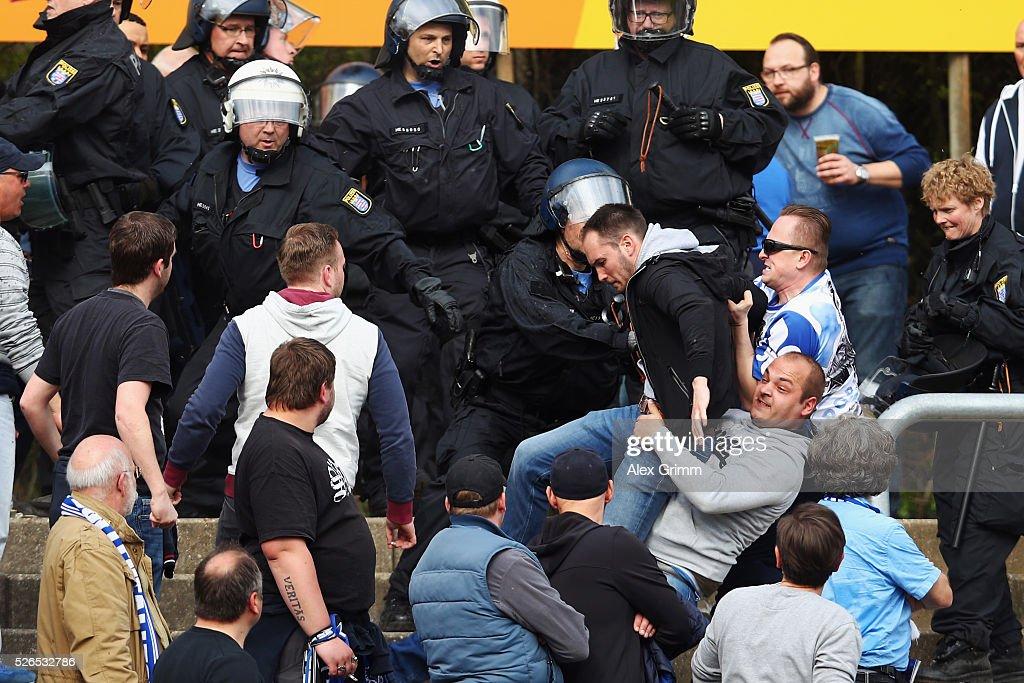 Fans fight during the Bundesliga match between SV Darmstadt 98 and Eintracht Frankfurt at Merck-Stadion am Boellenfalltor on April 30, 2016 in Darmstadt, Hesse.