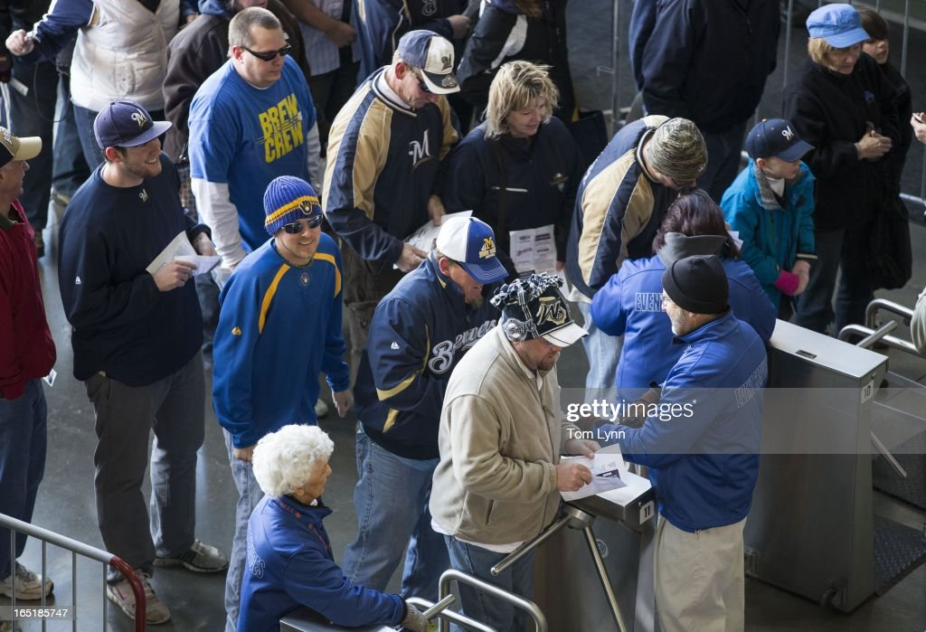 Fans file through the turnstiles as the stadium opens for the game between the Milwaukee Brewers and Colorado Rockies on opening day at Miller Park on April 1, 2013 in Milwaukee, Wisconsin.