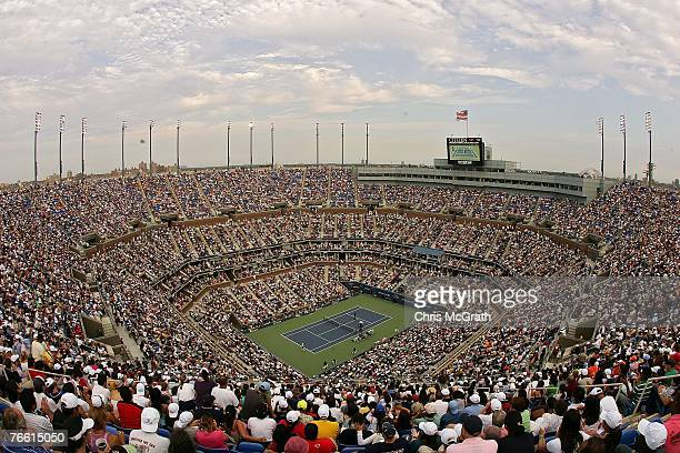 Fans fill Arthur Ashe Stadium as Roger Federer of Switzerland takes on Novak Djokovic of Serbia during the Men's Singles Final on day fourteen of the...