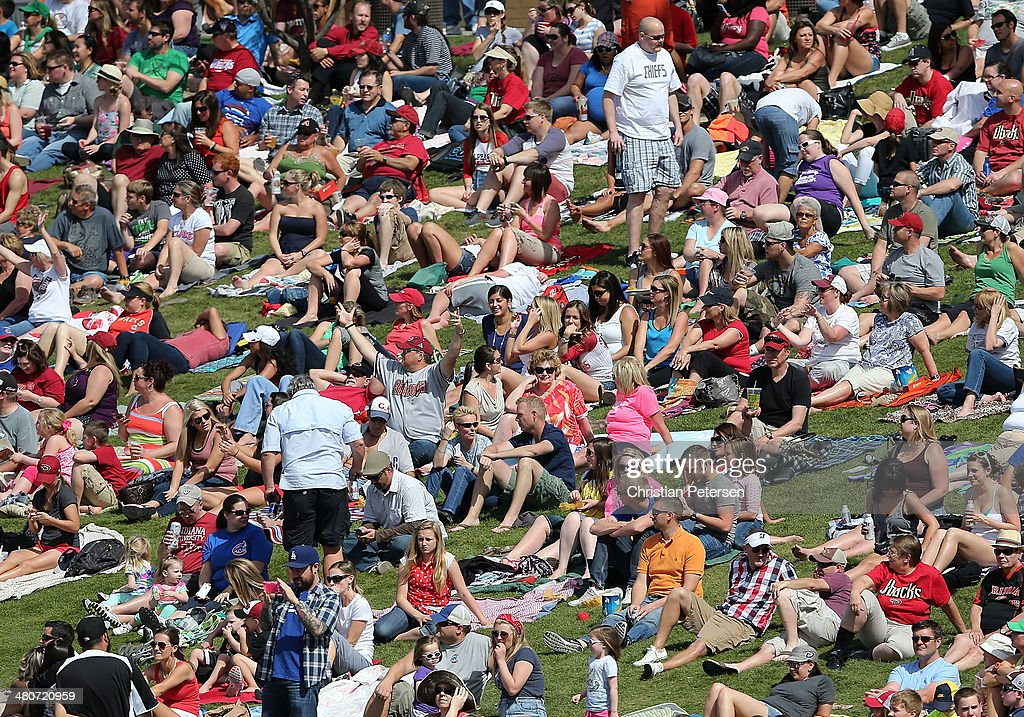 Fans fill the outfield grass during the spring training game between the Arizona Diamondbacks and the Chicago Cubs at Salt River Fields at Talking...