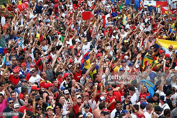 Fans fill the pit straight after the Formula One Grand Prix of Brazil at Autodromo Jose Carlos Pace on November 15 2015 in Sao Paulo Brazil