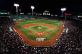 Fans fill the stands as the Cleveland Indians take on the Boston Red Sox during Game Two of the American League Championship Series at Fenway Park on...