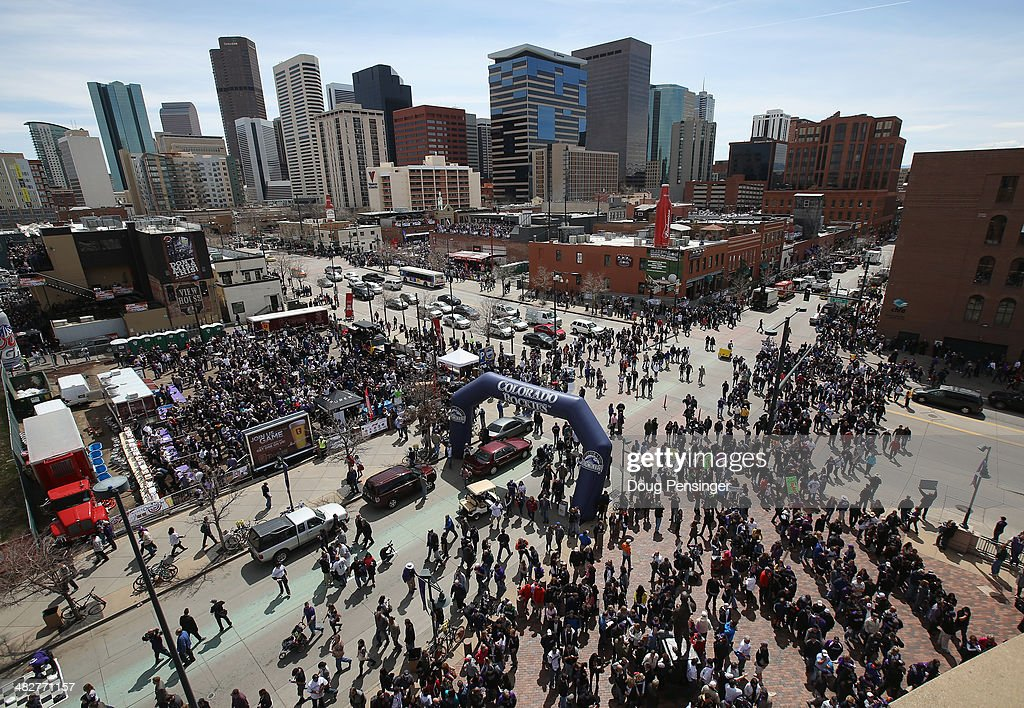 Fans flood the intersection of Blake Street and 20th Street as they head into the stadium to watch the Arizona Diamondbacks face the Colorado Rockies during the home opener at Coors Field on April 4, 2014 in Denver, Colorado.