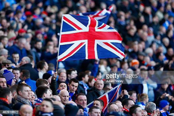 Fans fly a Union Jack flag during the Scottish League Cup SemiFinal between Celtic and Rangers at Hampden Park on February 1 2015 in Glasgow Scotland