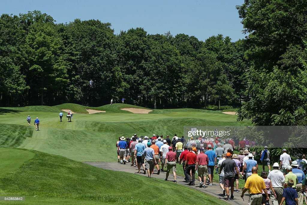 Fans follow a group of players down the fairway on the 15th hole during the first round of the Champions Tour American Family Insurance Championship at University Ridge Golf Course on June 24, 2016 in Madison, Wisconsin.