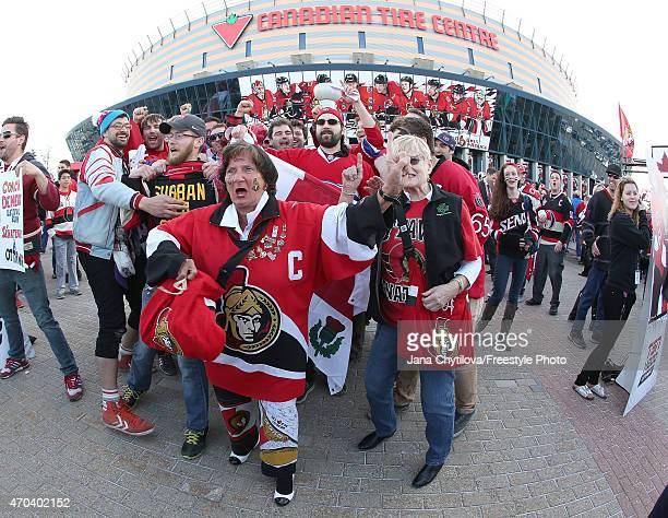 Fans for both teams battle for prominence prior to the start of a playoff game between the Ottawa Senators and the Montreal Canadiens during Game...