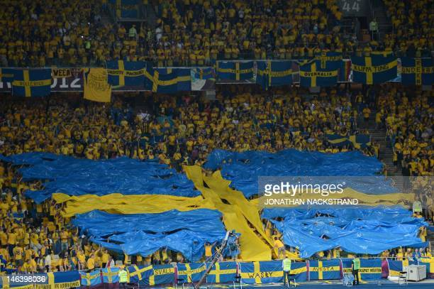 Fans form a Swedish flag before the Euro 2012 championships football match Sweden vs England on June 15 2012 at the Olympic Stadium in Kiev AFP PHOTO...